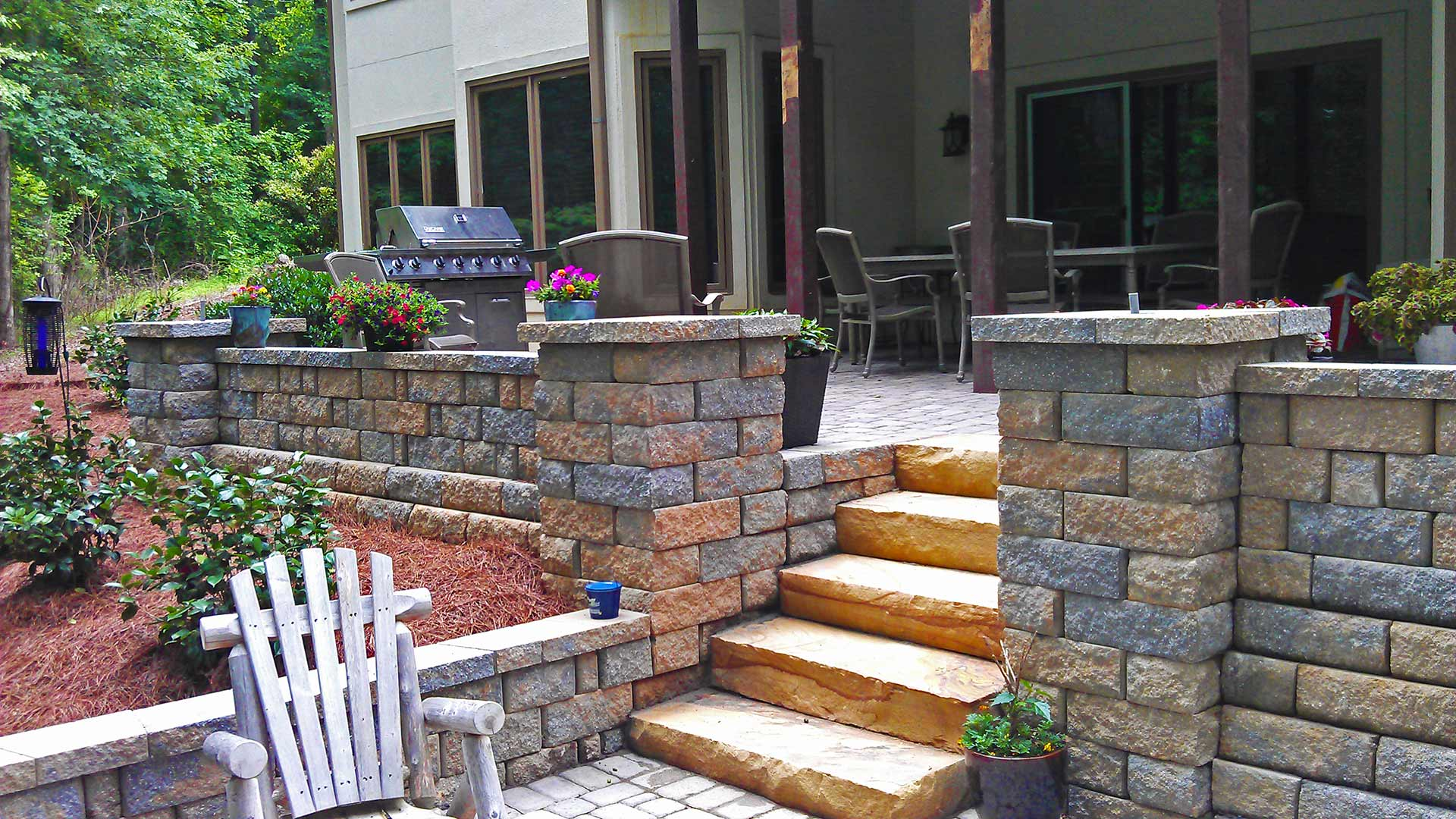Custom stone retaining wall and stairs built at a Sandy Springs, GA home.