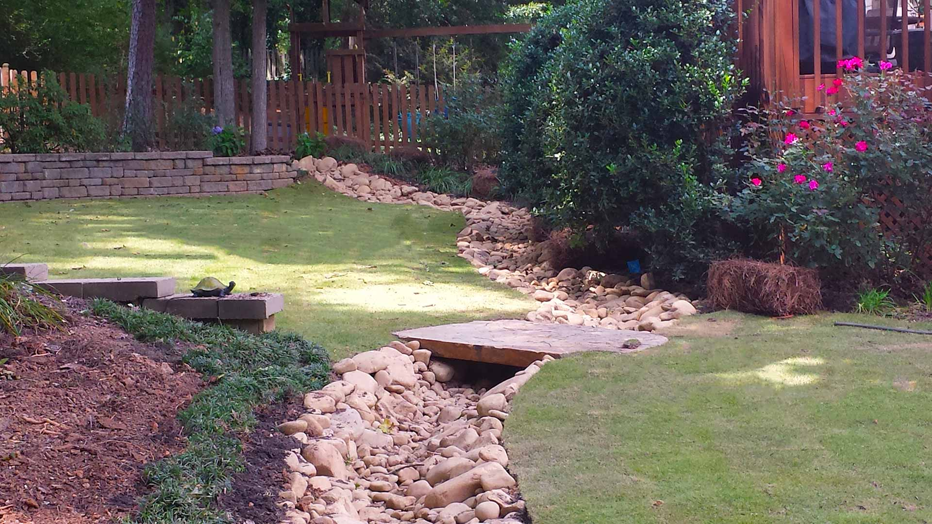 Drainage Solutions: French Drains vs. Dry Creek Beds