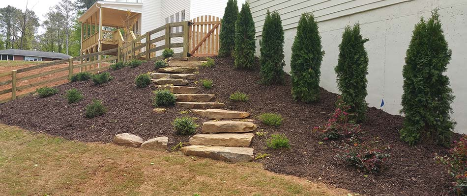Landscape bed renovation and stone steps construction in Sandy Springs, GA.