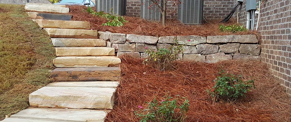 Pine mulch landscape bed and stone steps in Acworth, GA.