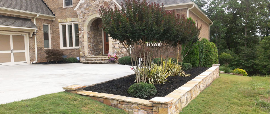 A residential property in Woodstock that our team trimmed their trees, hedges, and shrubs.