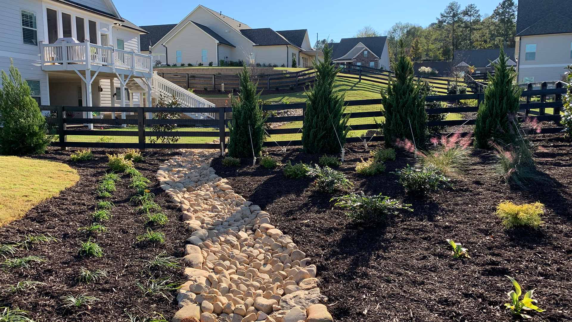 Custom Landscape Design with Dry Creek Bed in Marietta, GA
