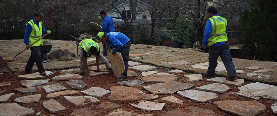 O'Neill Landscape Group workers installing flagstone patio in Roswell, GA.